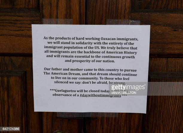 A sign outside the Guelaguetza Mexican restaurant announces they are closed for the day in solidarity with the Day Without Immigrants nationwide...