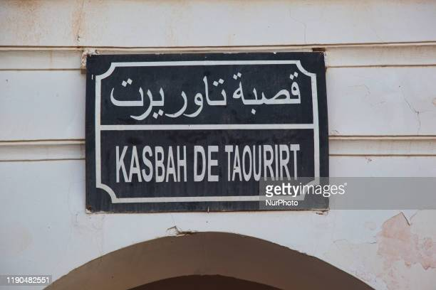 Sign outside the historic Taourirt Kasbah located in the Atlas Mountains in Ouarzazate, Morocco, Africa on 4 January 2016. The Kasbah dates back to...