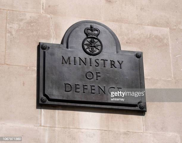 sign outside the ministry of defence in whitehall, london - department of defense stock pictures, royalty-free photos & images