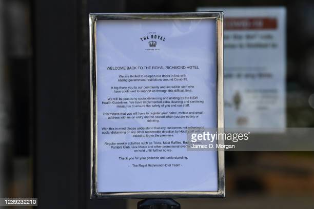 Sign outside the Royal Hotel requesting patrons register their details with the staff for potential contact tracing for the first day trading after...