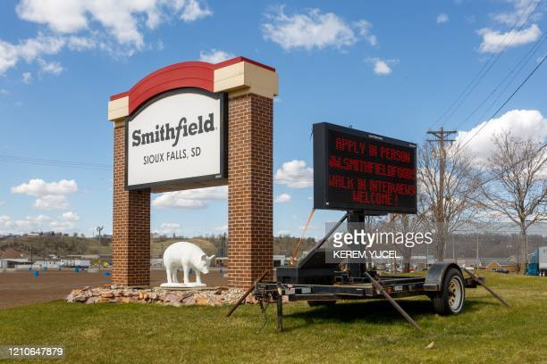 A sign outside the Smithfield Foods pork processing plant in South Dakota one of the countrys largest known Coronavirus clusters is seen on April 21...