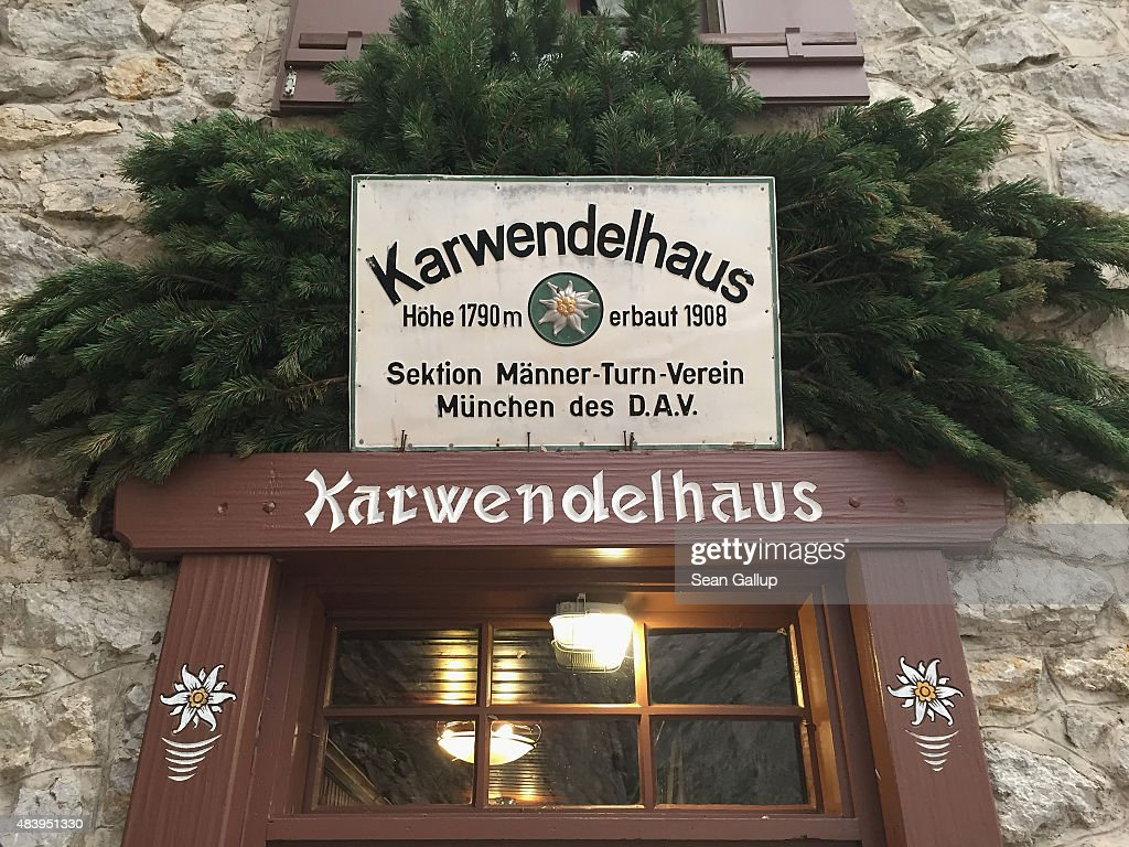 A sign over the Karwendelhaus mountain hut entrance shows the hut was built in 1908 by members of the Munich chapter of the German Alpine Club (Deutscher Alpenverein) in the Karwendel mountain range on August 7, 2015 near Scharnitz, Austria. The Karwendel mountain range, part of the Austrian Alps, is located in central Tyrol and is a popular summer destination for mountain bikers, climbers and hikers. Mountain huts operated by alpine clubs and scattered across the region offer food and shelter.