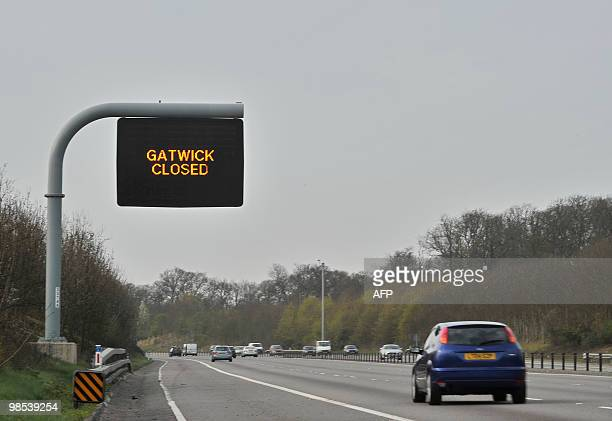 A sign over the M23 motorway in West Sussex on April 19 announces that Gatwick Airport is closed following air travel disruption caused by an...