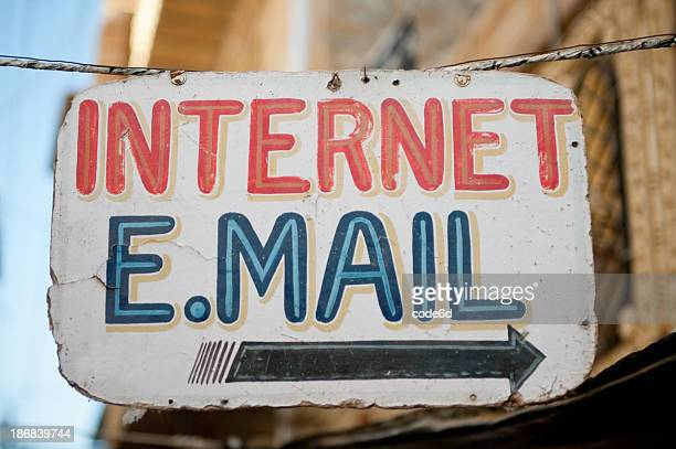 sign painted with the words internet and email - internet cafe stock pictures, royalty-free photos & images