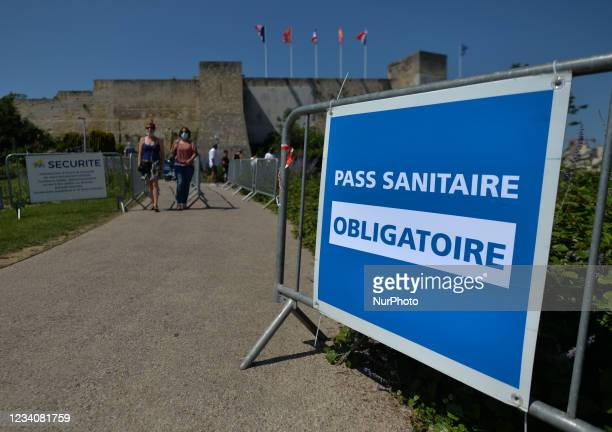 Sign 'Pass Sanitaire - Compulsory' seen at the entrance to the Château de Caen. On Wednesday, July 20 in Caen, Calvados, Normandy, France.