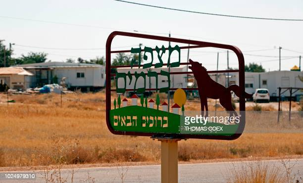 A sign placed at the entrance of the Israeli settlement of Mitzpe Kramim reads in Hebrew 'Mitzpe Kramim Welcome established in 1999' on August 29...