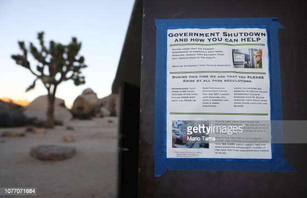 Sign placed by a volunteer is taped to a restroom door at Joshua Tree National Park on January 4, 2019 in Joshua Tree National Park, California....