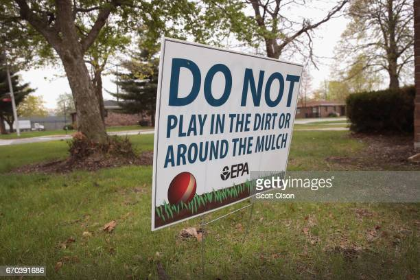 A sign placed by the EPA warns people not to play on the lawn at the West Calumet Housing Complex on April 19 2017 in East Chicago Indiana Nearly all...