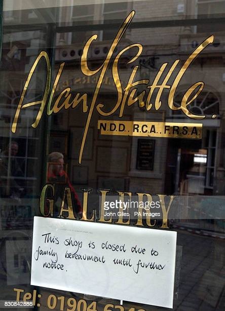 A sign placed in the window of the art gallery in York belonging to local artist Alan Stuttle with a sign in the window explaining that the shop is...