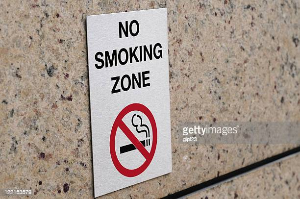 a sign placed on a no smoking zone - no smoking sign stock pictures, royalty-free photos & images
