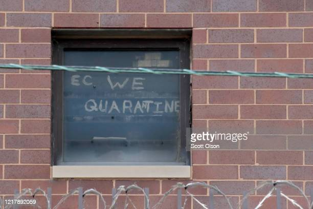 A sign pleading for help hangs in a window at the Cook County jail complex on April 09 2020 in Chicago Illinois With nearly 400 cases of COVID19...