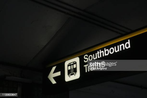 sign pointing the way to southbound trains - underground sign stock pictures, royalty-free photos & images