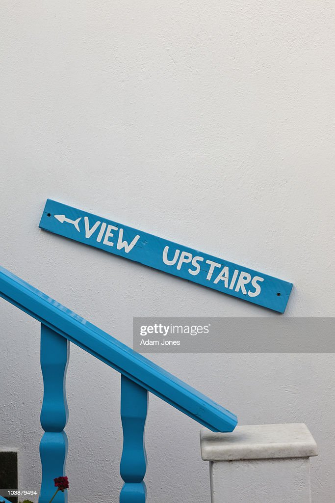 Sign pointing to view upstairs : Stock Photo