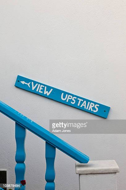 Sign pointing to view upstairs