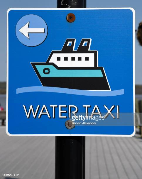 Sign points the way to a Potomac River water taxi in the Old Town section of Alexandria, Virginia.