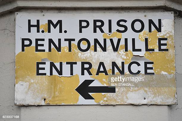 A sign points the way to the entrance of HM Prison Pentonville in north London on November 15 2016 Thousands of prison officers in Britain have...