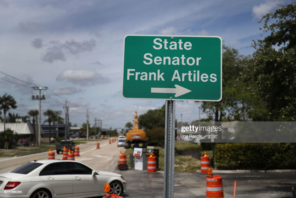 A sign points the way to the office of State Senator Frank Artiles who resigned today from the Florida Senate on April 21, 2017 in Miami, Florida. Mr. Artiles resigned after he insulted two lawmakers at a Tallahassee bar with racists and sexist remarks.