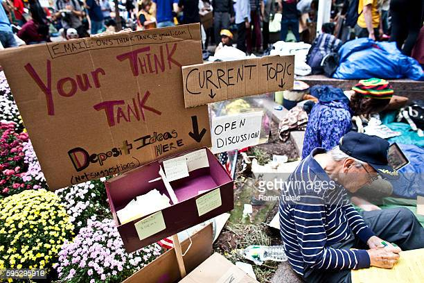 A sign points to a think tank discussion area created by Occupy Wall Street movement in Zuccotti Park where hundreds of protestors have been living...