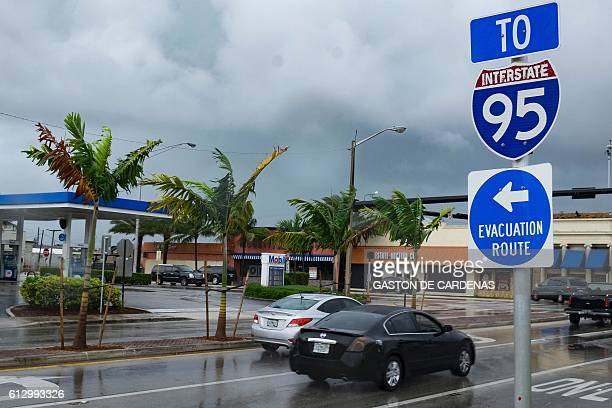A sign points to an evacuation route as South Florida residents prepare for the arrival of Hurricane Matthew on October 6 2016 in Pompano beach...