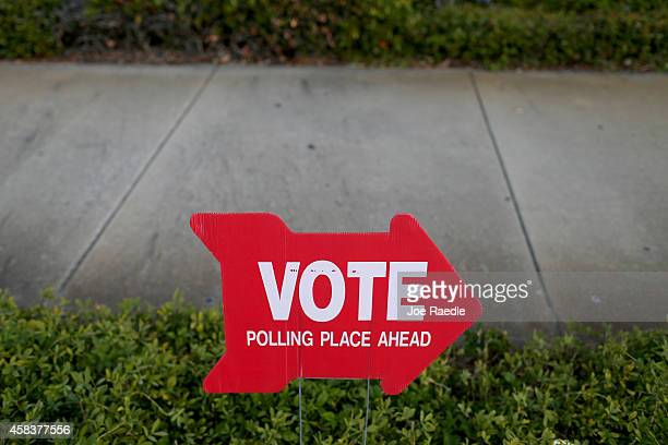 A sign points to the The Coliseum where a polling station is setup on November 4 2014 in St Petersburg United States Today Americans head to the...