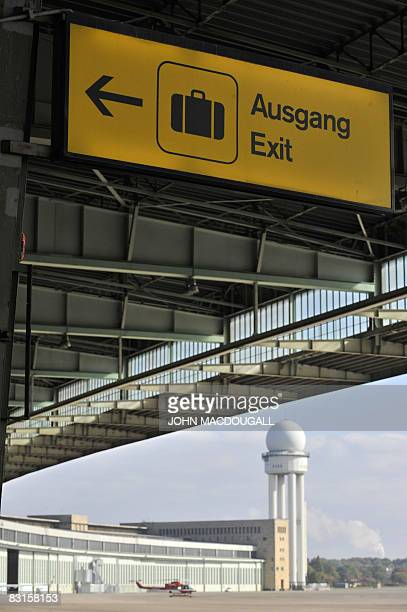 Sign points towards the exit outside the main terminal of Tempelhof airport in Berlin October 7, 2008. The airport, originally built in 1923, was...