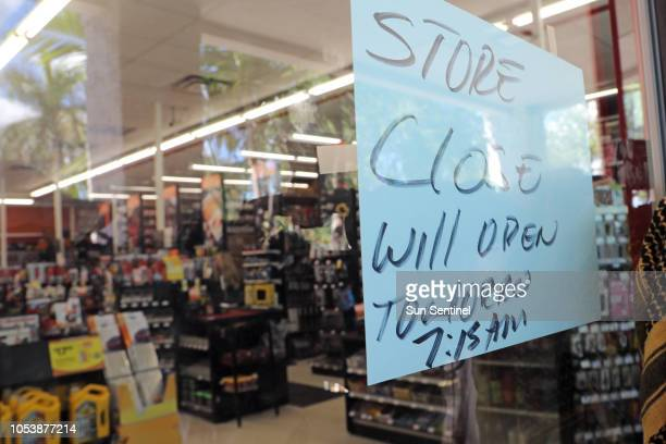 A sign posed on the door says the AutoZone store will be closed until Saturday morning Photographed on State Road 7 in Plantation where Cesar Sayoc...