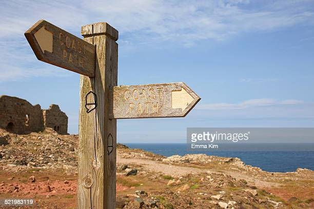 Sign post and tin mine ruins on coastal path, Trewellard, Penzance, Cornwall, UK