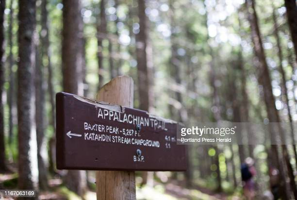 Sign post directs hikers on the Hunt Trail, a section of the Appalachian Trail and popular route to Baxter Peak on Mt. Katahdin.