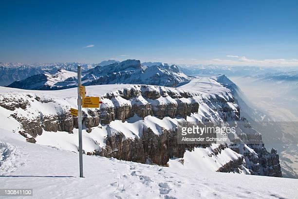 Sign post on Mt. Chaeserrug with a view towards Sargans and the Rhine Valley, snow, Unterwasser, Toggenburg, Canton St. Gallen, Switzerland, Europe