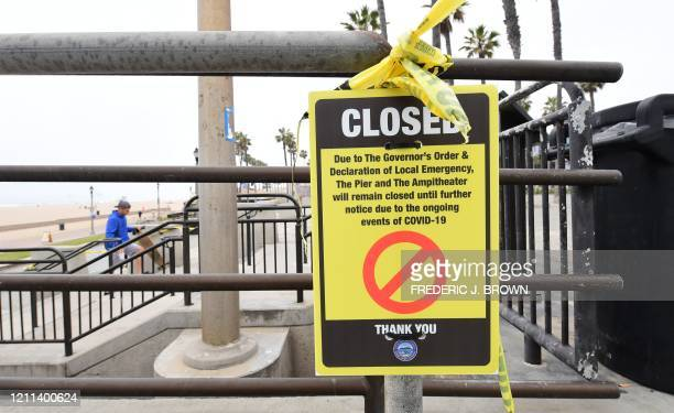 A sign posted announcing closures due to COVID19 is seen at Huntington Beach California on April 30 2020 California Governor Gavin Newsom announced...
