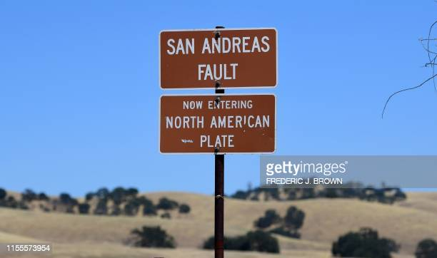 A sign posted at the San Andreas Fault separating the Pacific and the North American tectonic plates near Parkfield California on July 12 2019 in a...