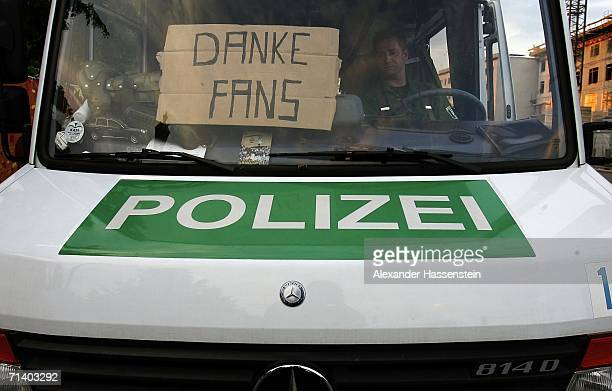 A sign posted by German Police reads Thanks Fans while watching the FIFA World Cup 2006 final match between France and Italy at the Fan Fest outdoor...