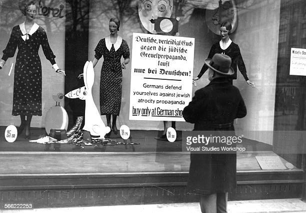 A sign posted in a shop owned by Jewish people advising Germans to buy from Germanowned shops only was one of the steps taken by the Nazis in their...