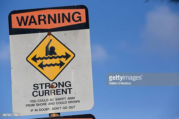Sign posted on beach warning against strong current on November 12 2015 in Haleiwa Hawaii