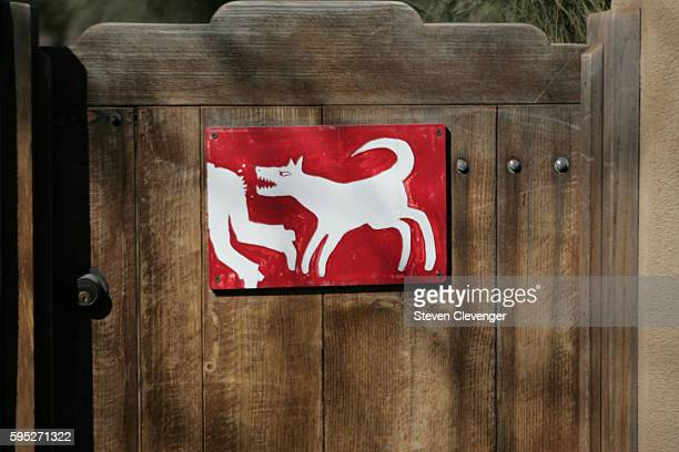 A sign posted on the garden door of an upscale Canyon Road home on the east side of Santa Fe warns wouldbe trespassers to beware of the dog