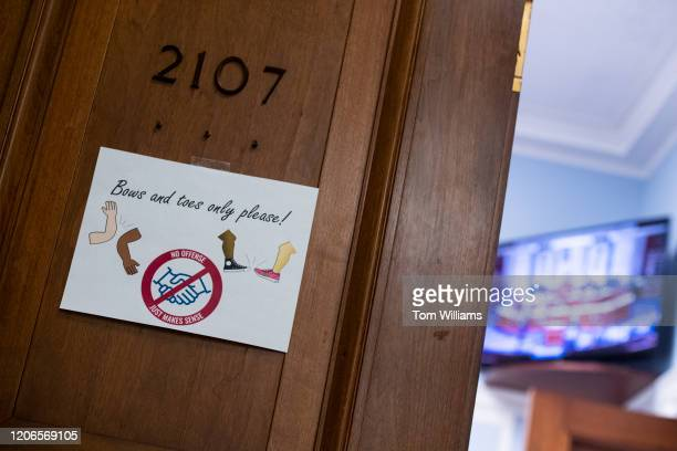 A sign posted outside the office of Rep Frank Pallone DNJ states policies instated to ward off the spread of coronavirus in Rayburn Building on...