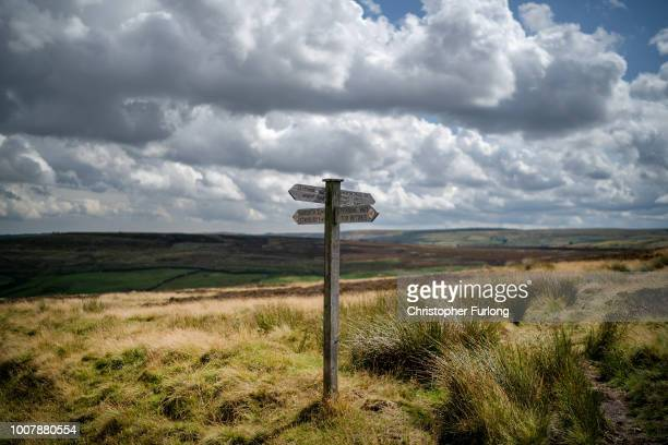 Sign posts direct walkers and Bronte fans across the North Yorkshire moors near Haworth believed to be the setting for Emily Bronte's romantic novel...