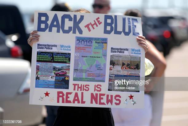 A sign posts real news and calls to back the blue at a Back the Blue rally in support of police departments on Quincy Shore Drive in Quincy MA on...