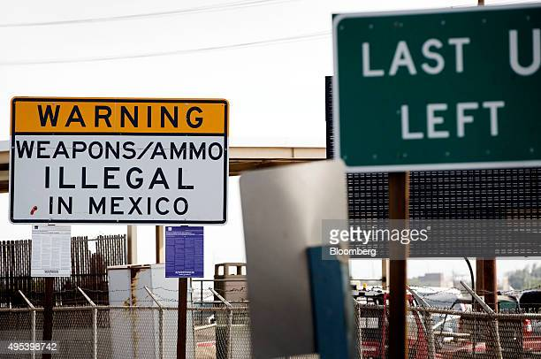 A sign prohibiting the transport of weapons and ammunition into Mexico stands at the US Border Inspection Station in Calexico California US on Monday...
