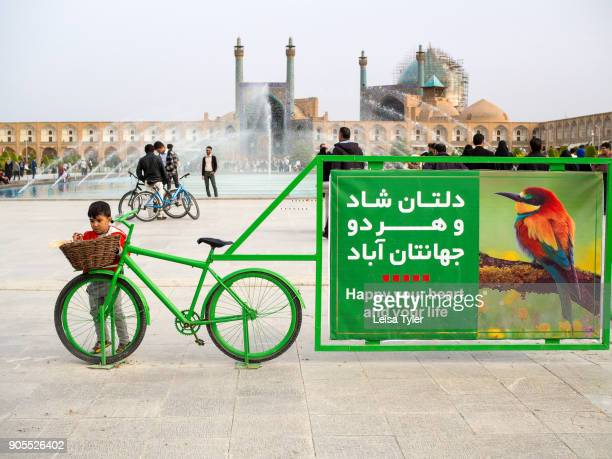 A sign promoting happiness in Maydane Imam Square also known as Naqshe Jahan Square in Esfahan Iran It is a UNESCO World Heritage Site