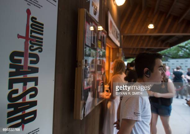 A sign promoting Julius Caesar is displayed on opening night of Shakespeare in the Park's production of Julius Caesar at Central Park's Delacorte...