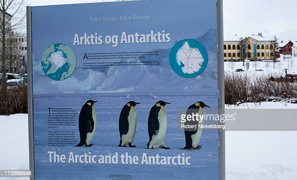 Sign promoting scientific research in the Svalbard region of Norway stands in front of a building where the Arctic Council has its offices in Tromso,...