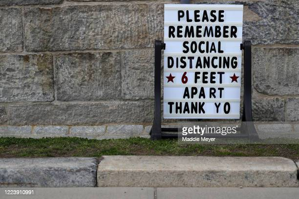 Sign promoting social distancing at Fort Adams State Park on May 09, 2020 in Newport, Rhode Island. Non-critical retail establishments began opening...
