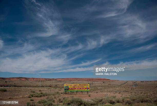 Sign promoting social distancing sits near the Navajo Nation town of Chinle during the 57-hour curfew imposed to try to stop the spread of the...
