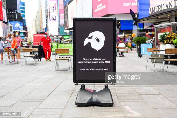 A sign promoting the wearing of face masks is seen in Times Square as New York City moves into Phase 3 of reopening following restrictions imposed to...