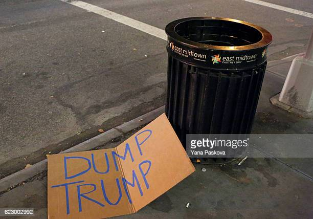 A sign protesting new Republican presidentelect Donald Trump lies discarded by a garbage can in Midtown on November 12 2016 in New York United States