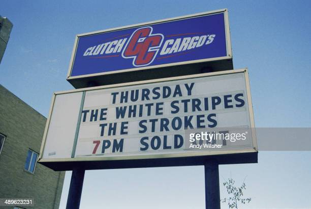 A sign publicising a soldout concert by American rock groups The White Stripes and The Strokes outside the Clutch Cargo's venue in Pontiac Michigan...