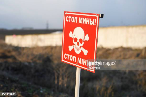Sign quotCareful minesquot near Checkpoint quotHnutovequot in Hnutove village near Mariupol Ukraine on 12 January 2018