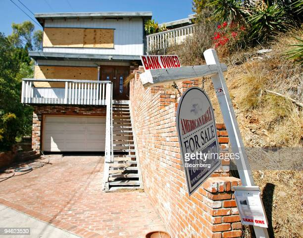 A sign reading Bank Owned' hangs outside a boarded up home in La Mesa California on Sunday Sept 23 2007 When Kansas City Federal Reserve Chairman Tom...
