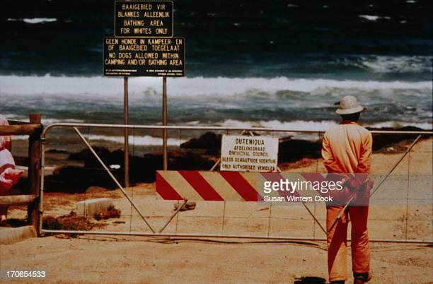 A sign reading 'Bathing area for Whites Only' on a beach at Victoria Bay Western Cape South Africa under apartheid 1988